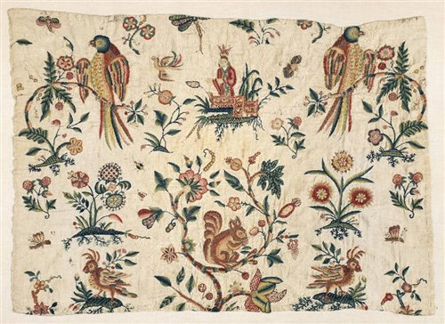 Lot 321-An early crewelwork panel, late 17th/early 18th century