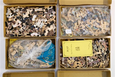 Lot 518-Jigsaw Puzzles.  A collection of 19 jigsaw puzzles, early 20th century