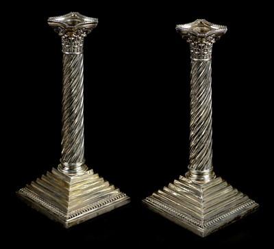 Lot 40-Candlesticks. A pair of Victorian silver Corinthian column candlesticks by H.F., London, 1891