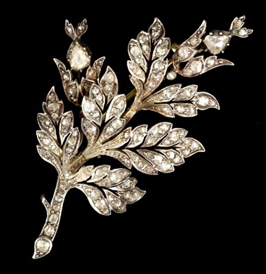 Lot 9-Brooch. A Victorian gold and diamond leaf brooch