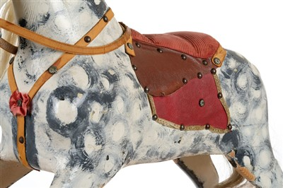 Lot 522-Rocking Horse. An English dapple grey rocking horse by J. Collinson and Sons, circa 1950s