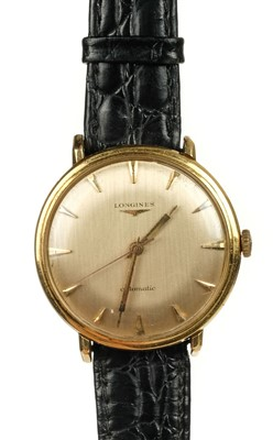 Lot 34-Longines. A gentleman's Longines Automatic 18K gold wristwatch