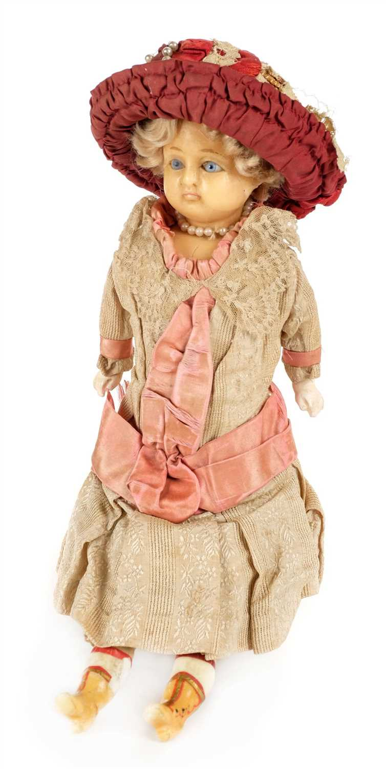 Lot 515-Doll. A late Victorian wax headed doll