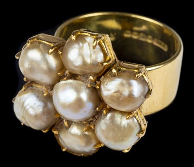 Lot 23-Ring. An 18ct gold ring by Charles Green & Son
