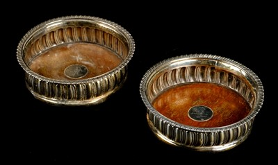 Lot 42-Coasters. A pair of Georgian silver wine bottle coasters by Thomas Newby, London 1816