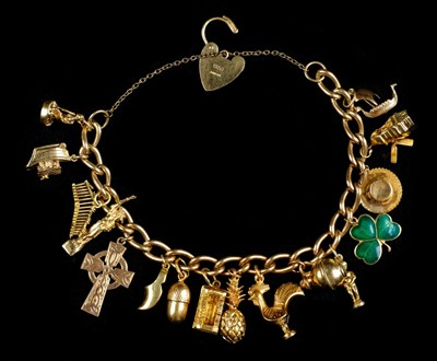 Lot 2-Bracelet. A 9ct gold hollow link charm bracelet