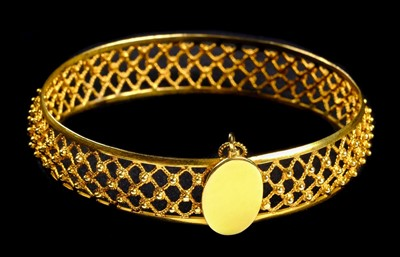 Lot 1-Bangle. A Continental 18ct gold ladies bangle