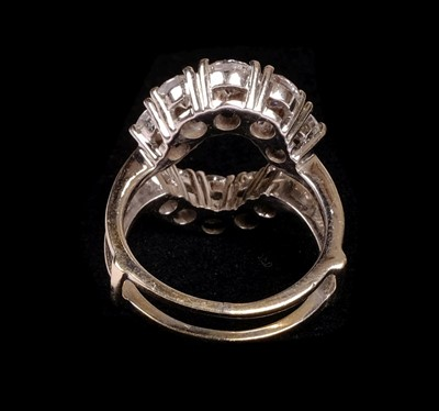 Lot 23 - Ring. An 18ct white gold jacket ring set with 10 brilliant cut diamonds