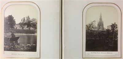 Lot 11-Scotland. An album containing 30 window-mounted albumen print views of Scotland, c. 1870s