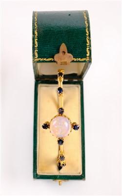 Lot 2 - Bangle. An opal and sapphire bangle