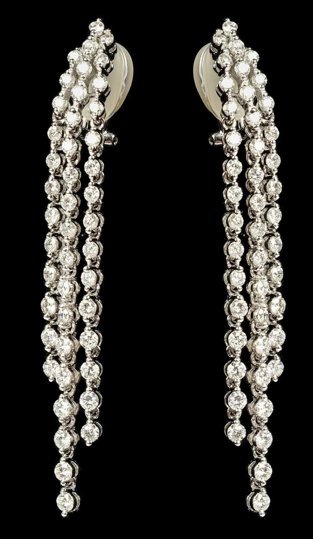 Lot 12 - Earrings. A pair of ladies 18K white gold diamond drop earrings