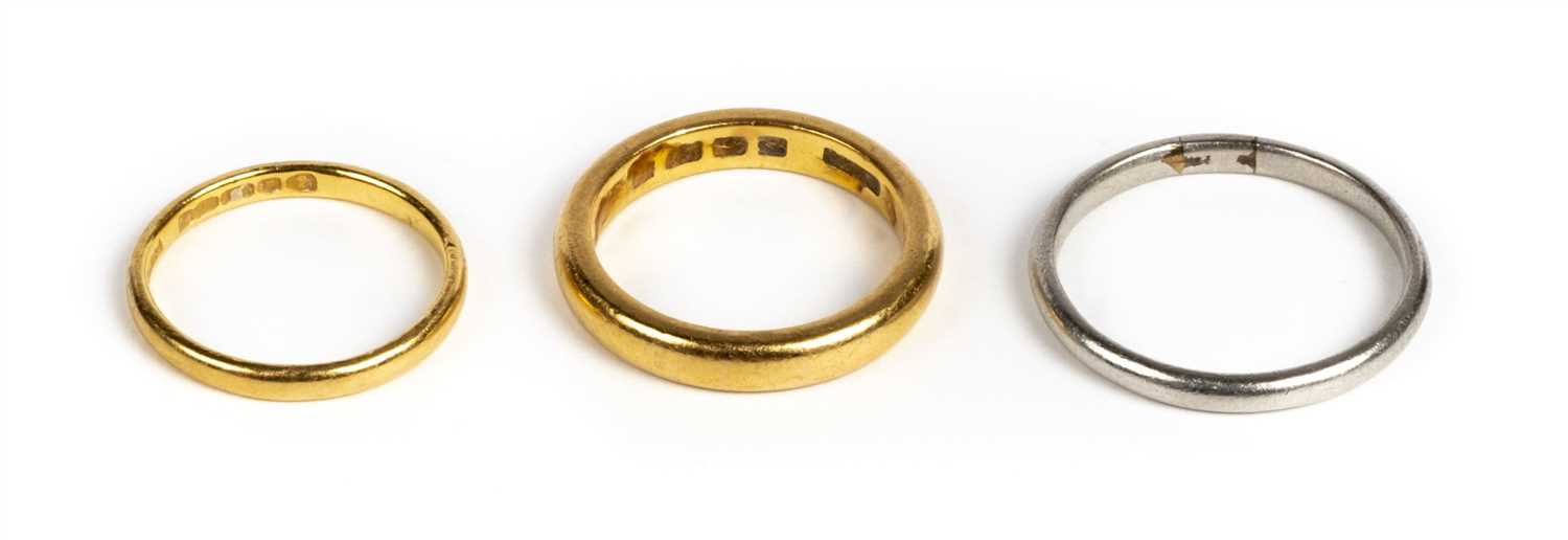 Lot 34 - Rings. Two 22ct gold wedding bands plus a platinum ring