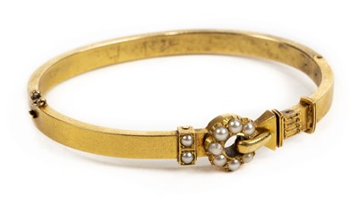 Lot 1 - Bangle. A Victorian yellow metal and pearl bangle