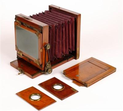 "Lot 311 - J. Lancaster & Son ""The International"" tailboard half-plate camera, circa 1886"