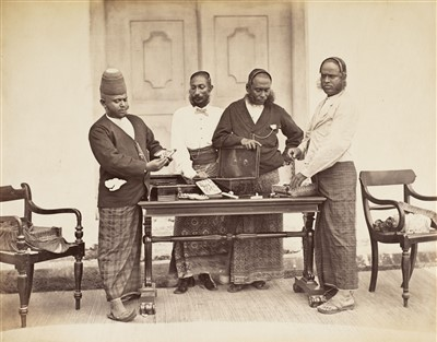 Lot 31-India. An album containing approximately 56 mounted albumen print views, c. 1870s