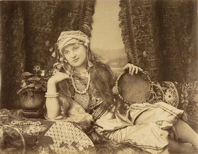 Lot 25-Turkey. Portrait of a Turkish woman reclining on a divan, by Hippolyte Arnoux, c. 1870