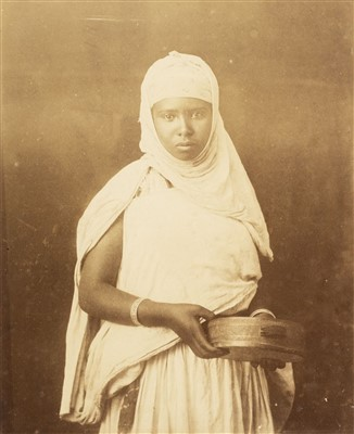Lot 22-North Africa. A portrait of a young North African woman holding a tambourine, c. 1880s