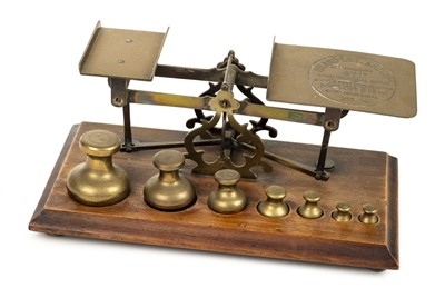 Lot 63 - Postal scales. A good set of Victorian brass postal scales