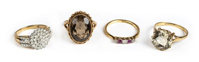 Lot 29 - Rings. A yellow metal diamond cluster ring plus 3 other rings