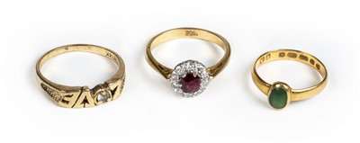 Lot 25 - Rings. A 22ct gold ring set with a green stone cabochon and 2 others