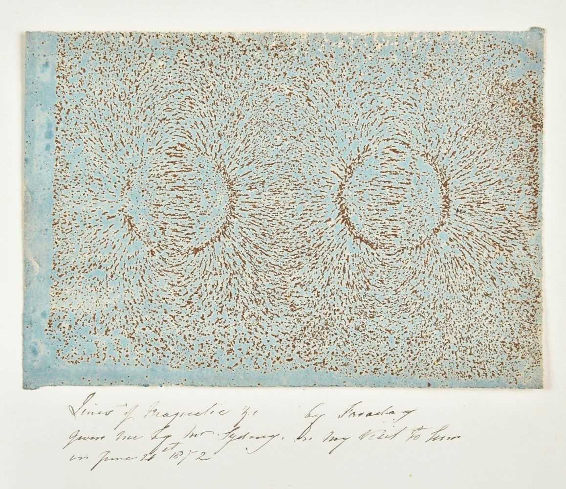 394 - Faraday (Michael, 1791-1867). An iron filings diagram fixed on wax blue paper, circa 1850s