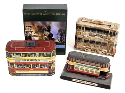 Lot 7-Trams - Collectable tins. A collection of tram car form biscuit tins, money boxes and related