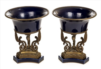 Lot 27-Urns. A pair of 18th century style urns