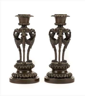 Lot 43-Candlesticks. A pair of 19th century French bronze candlesticks