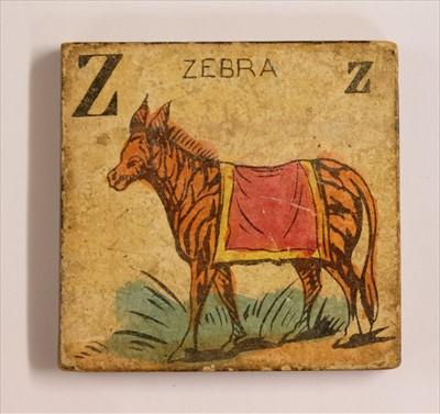 Lot 536 - Alphabet. A set of pictorial alphabet tiles, c. 1830s