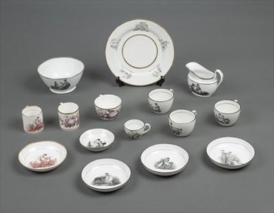 Lot 26-Tea wares. A collection of English porcelain bat printed tea wares