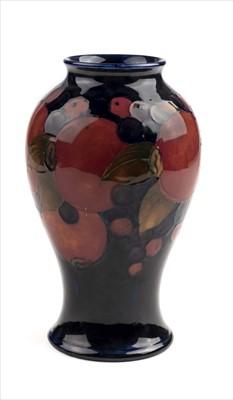 Lot 12-Moorcroft. A Moorcroft pottery 'Pomegranate' pattern vase