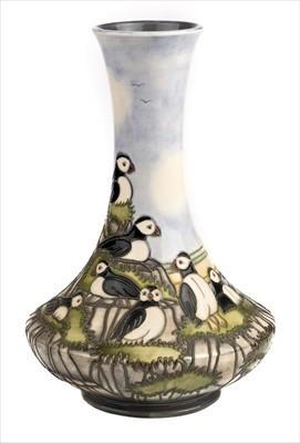 Lot 21-Moorcroft. A Moorcroft pottery 'Puffin' pattern vase designed by Kerry Goodwin