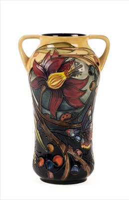Lot 16-Moorcroft. A Moorcroft pottery 'Hartgring' two handle vase