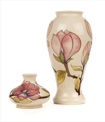 Lot 20-Moorcroft. A Moorcroft pottery 'Magnolia' pattern vase and two others