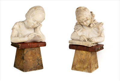Lot 31-Alabaster sculptures. A 1920s carved figure of a girl reading