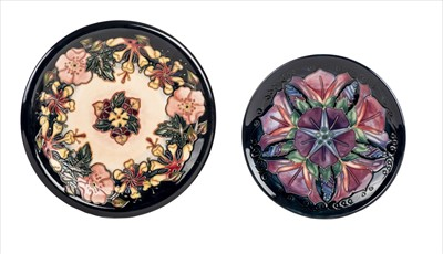 Lot 23-Moorcroft. Two Moorcroft pottery floral decorated plates