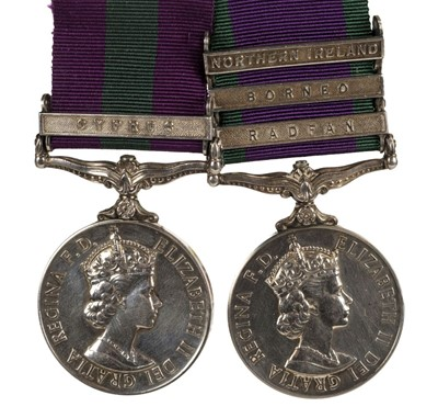 Lot 22-General Service Medal. A pair of medals - Corporal E. Swain, Royal Signals