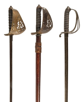 Lot 13-Swords. An 1822 pattern cavalry officer's sword plus two others