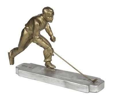 Lot 19-Ice Hockey. An art deco spelter Ice Hockey player