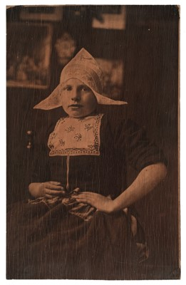 Lot 42-Dutch School. Portrait of a Dutch girl in traditional dress, early 1900s, carbon print