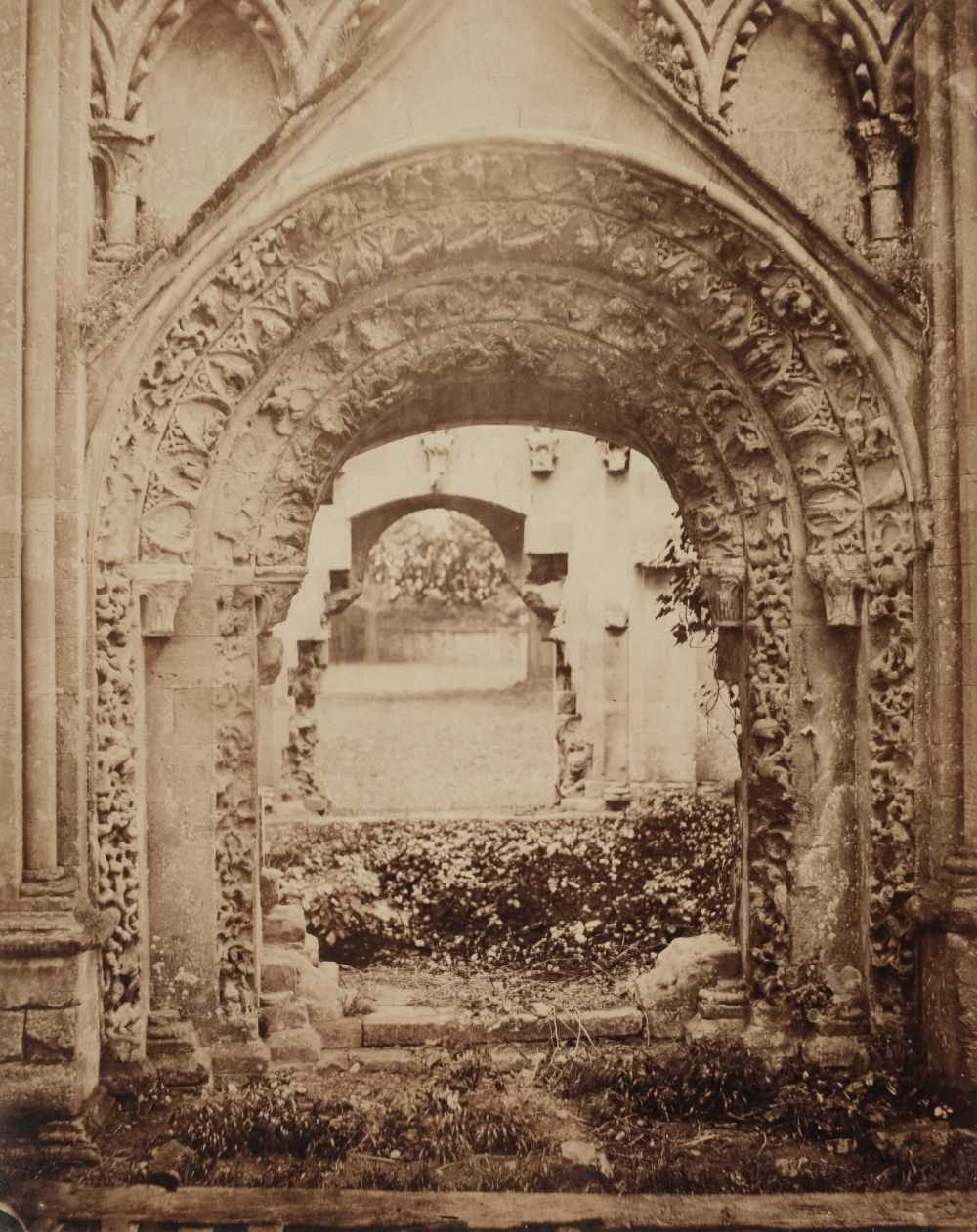 Lot 7-English School. A large-format toned albumen print of church cloisters, 1850s