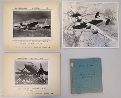 Lot 47-Gibson (Michael L.). A WWII log book and aviation ephemera