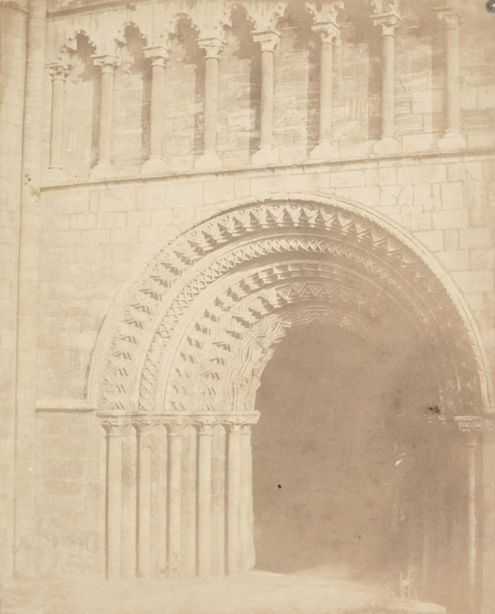 Lot 2-British School. A Norman church archway, c. 1840s, salted paper print on contemporary paper mount