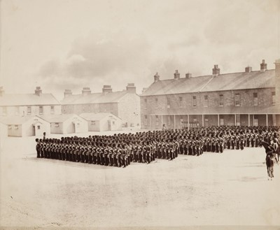 Lot 10-Attributed to Roger Fenton (1816-1869). Military Parade, with an officer on horseback