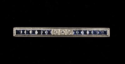 Lot 9 - Brooch. Art Deco diamond and sapphire bar brooch