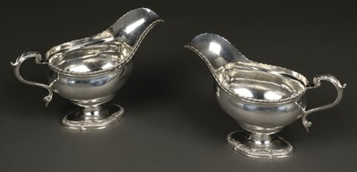 Lot 47 - Sauce Boats. A large pair of George V silver sauceboats