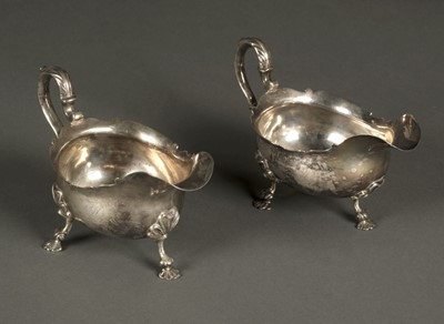 Lot 46 - Sauce Boats. A matching pair of George III silver sauce boats by George Hunter