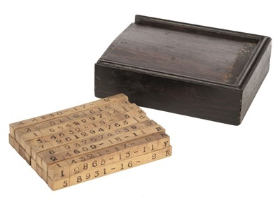 Lot 448 - Game. A boxed set of number and letter rods, early 19th century