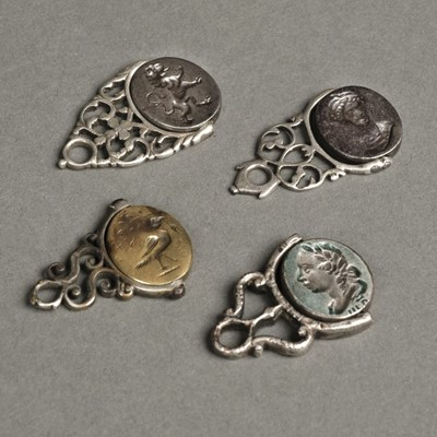 Lot 28 - Fobs. George III silver swivel fobs