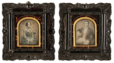 Lot 31 - Daguerreotypes. A pair of hand-tinted daguerreotypes of a seated young woman and young man, c. 1860